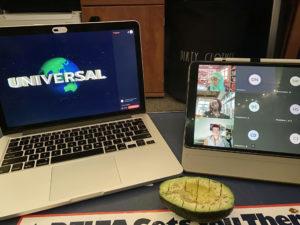 laptop, iPad, and half an avacado on a desk